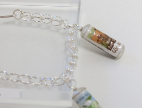 37.  PS I Love You  bracelet of sterling silver, paper, postage stamps, resin $190