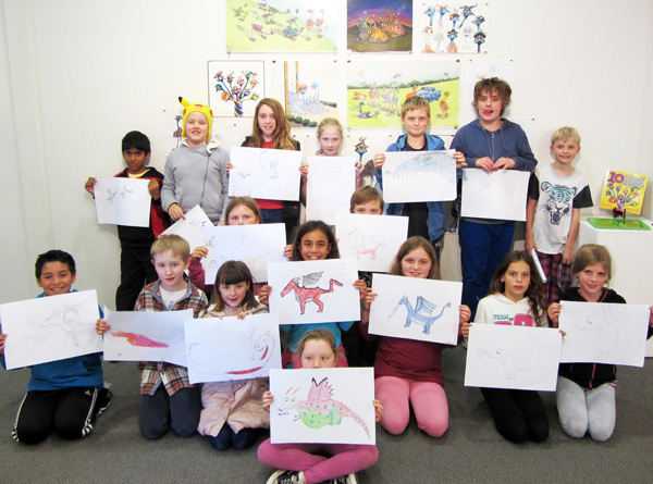Homeschoolers show their cartoons created with James Foley.jpg