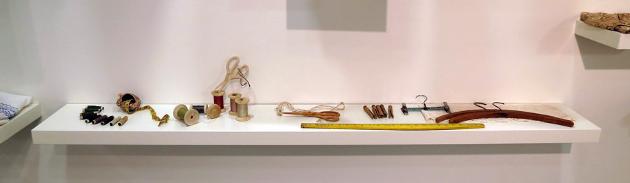 6.  Cloth-ing Shelf  by Lorna Murray hand-carved soft timber forms, thread, lace, found objects $345 (shelf not included)