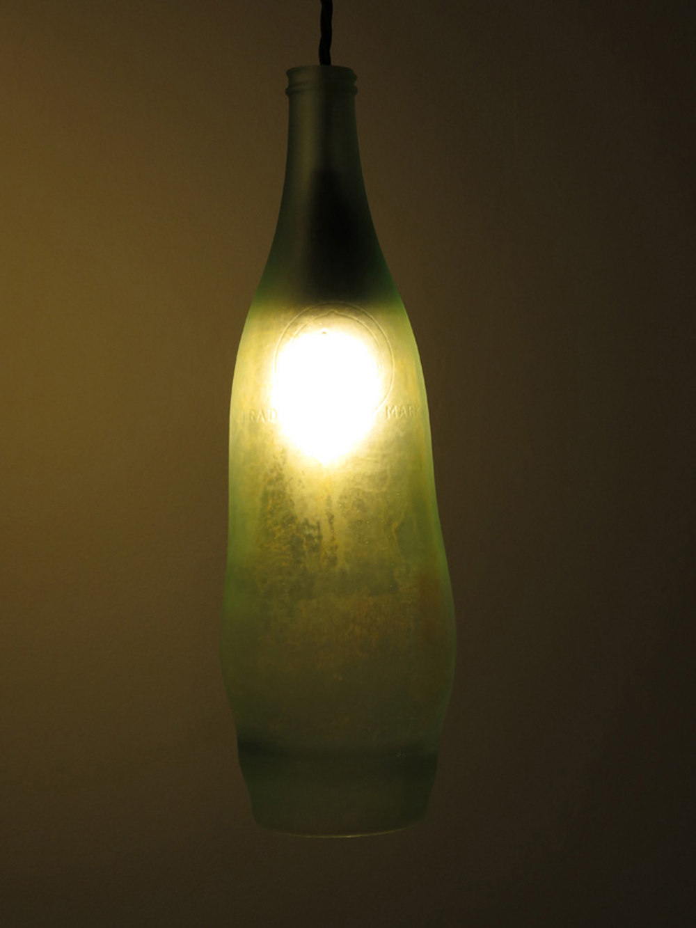 10.  Bottle 3 , Katherine Ashe, glass and bakelite, $675