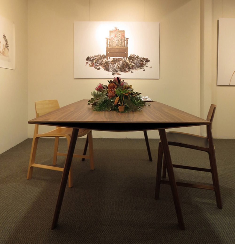 36.  Gerus Table , Adam Cruickshank, American Black Walnut, carbon fibre, $8,200  37.  Fletcher Chair , Adam Cruickshank, American Black Walnut, leather, $1300  38.  Fletcher Chair , Adam Cruickshank, hickory, full aniline leather, $1,300  Flowers by Mundaring Florists By Design