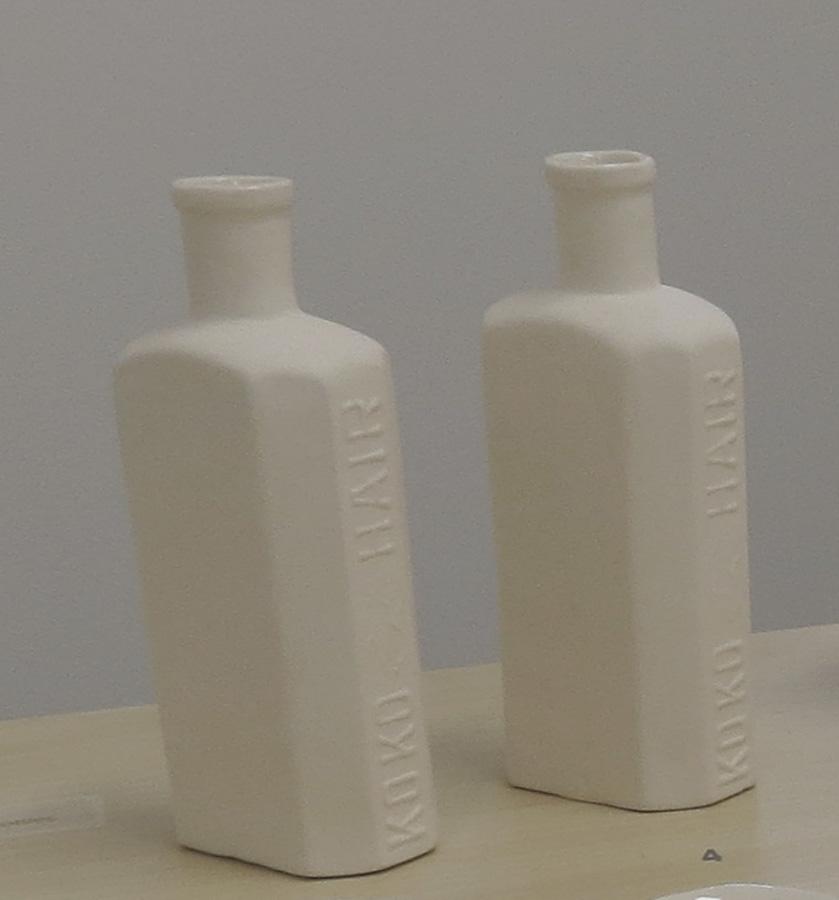 4.Louise Simonette, Medicine Bottles , slip cast porcelain,$38 each