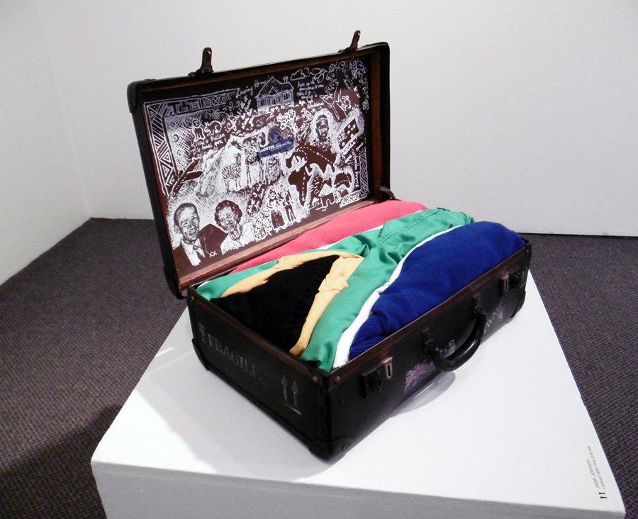 11. 'I Arrived With One Suitcase', Joan Johnson, old suitcase, paint, clothing, $615