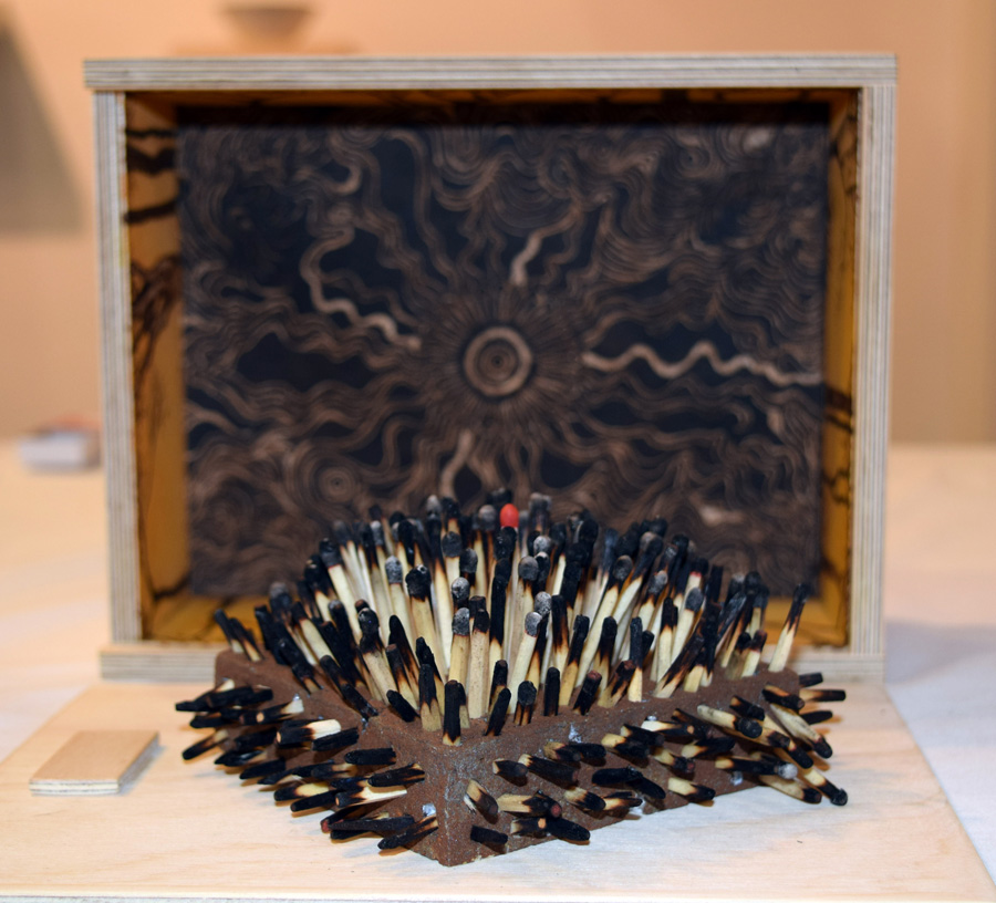 10. Sandie Schroder, 'It Only Takes One', pyrography, mixed media, matches