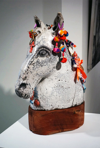 8. Marcia Espinosa,  The Protector, w hite raku, jarrah, ceramic objects, metal, ribbons and various ornaments, 54 x 18 x 35 cm, $1,200