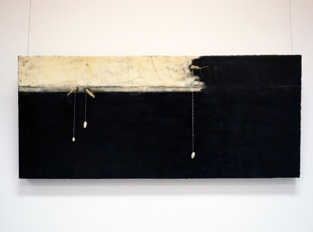 4. Marisa Tindall,  Coming into the world , 2017, wax, ground marri charcoal, cotton, sticks on ply, $750