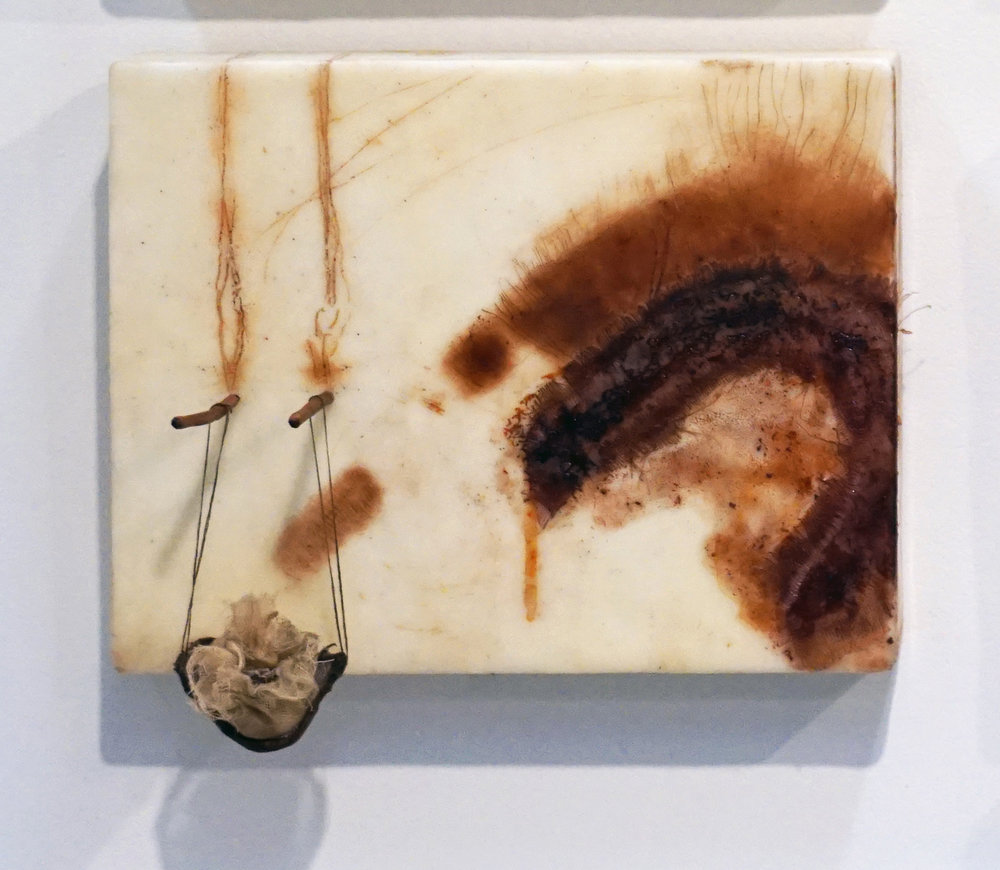 19. Marisa Tindall,  Brought forth into being 2,  2017, wax, ground marri charcoal, resin,     wood, cotton and gauze on ply, $245