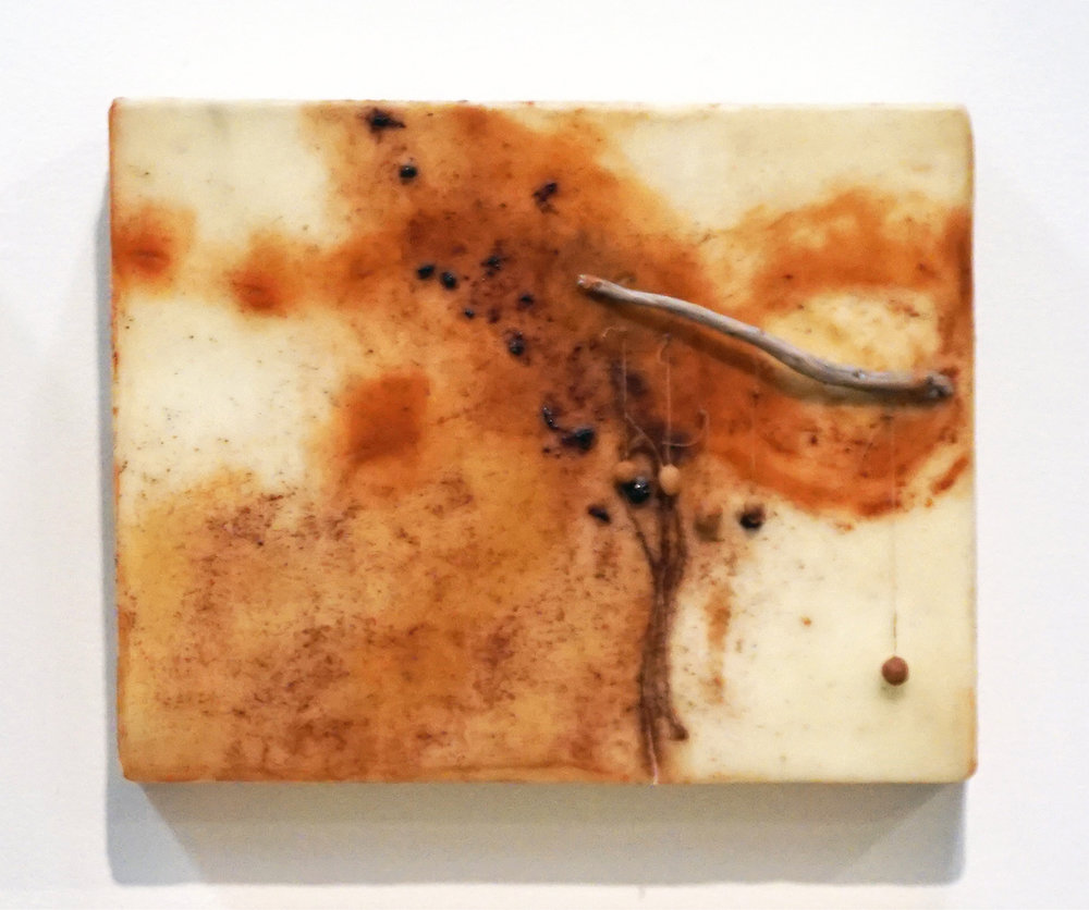 20. Marisa Tindall, Brought forth into being 3 , 2017, wax, ground marri charcoal, resin, wood, cotton and gauze on ply, $245