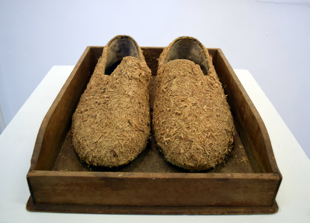 4. Nalda Searles,  The Wood Clearers Slippers,  2014, the artist's fathers slippers with sandalwood shavings from beneath his wood lathe, NFS