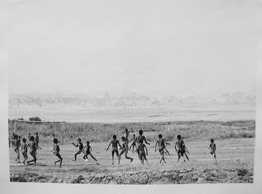 76. Richard Woldendorp, 'Boys playing soccer, West Irian Jaya, Indonesia', BW202b, taken in 1971, printed in 2013