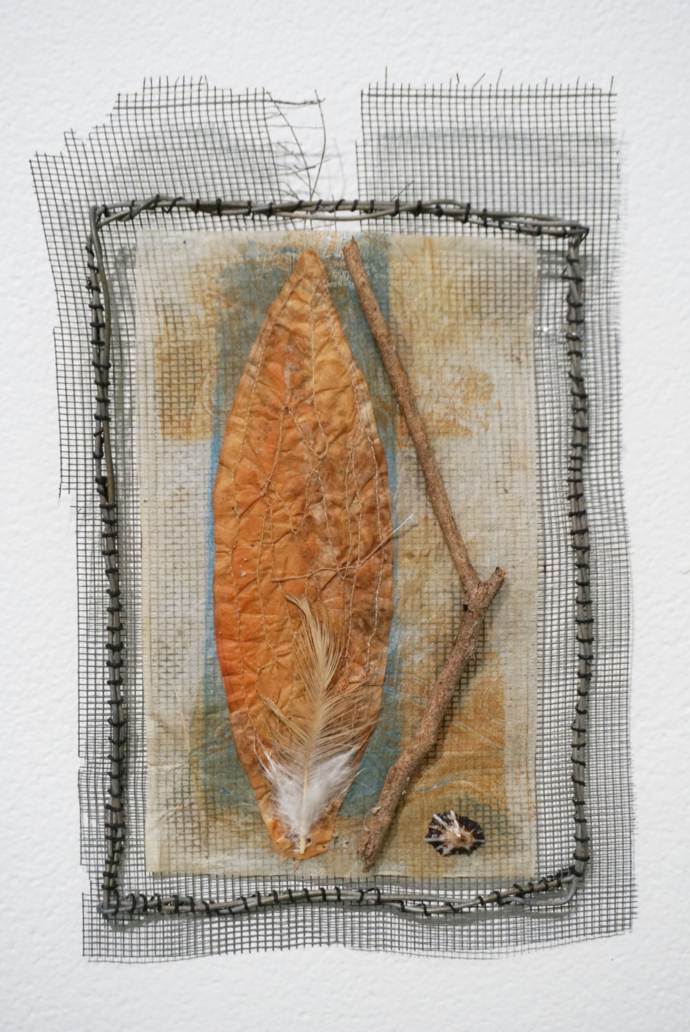 5. Andrea Day,  Of Land, Sea, Sky and Me , Flyscreen, wire, waxed linen, teabag, acrylic paint, shell, twig, feather $45