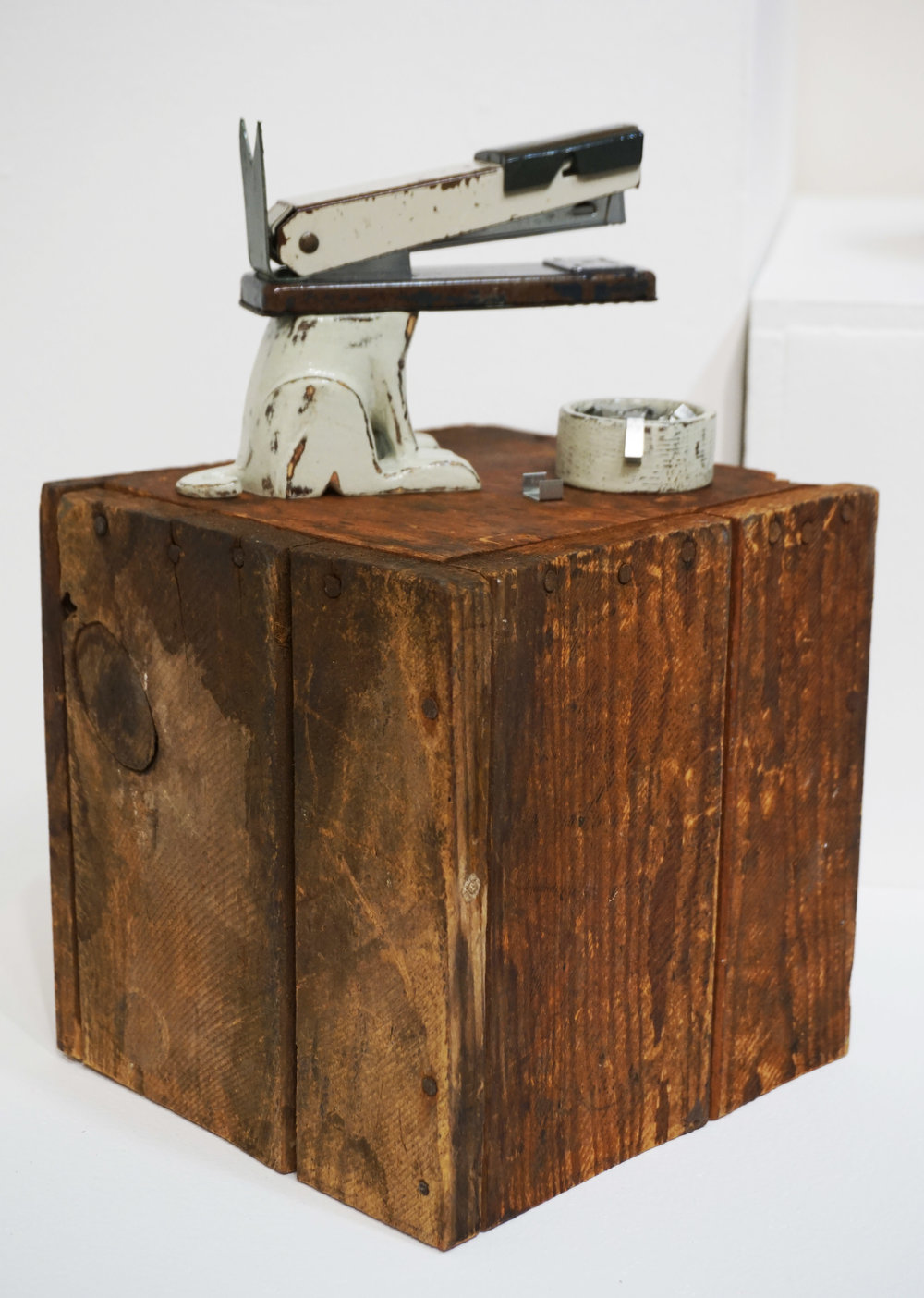 12. Neil Elliott,  Stapler Dog , Found objects and carved wood $900