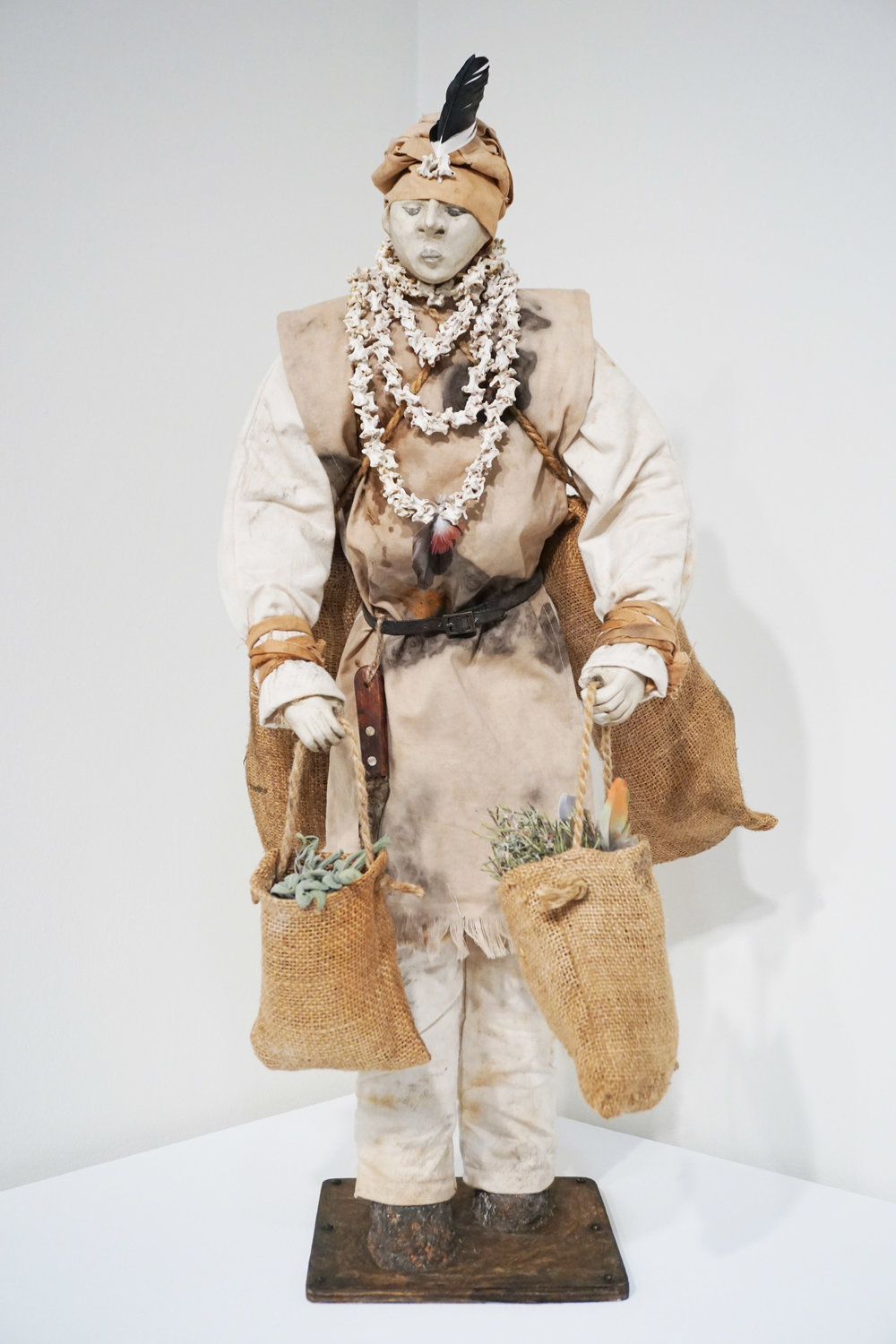 15. Cathy Swioklo,  The Collector , Porcelain, natural dyed cloth, metal, wood, bone, leather, plant material, feathers, paper maché $800