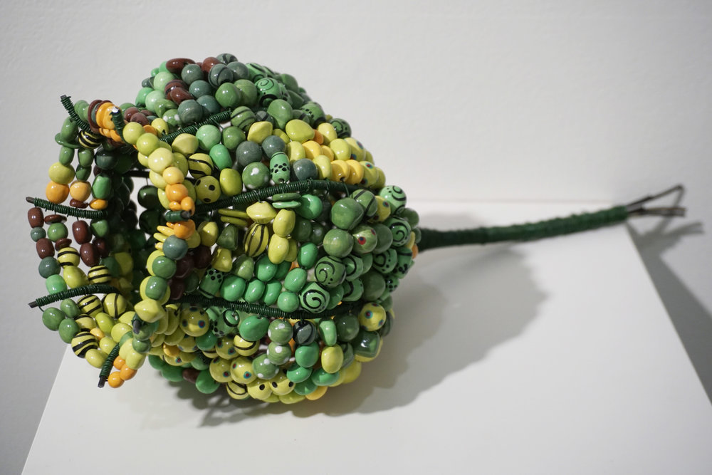 31. Sarah Keirle,  Wind-fallen Honkey Nut , Hand-made ceramics, wire $750