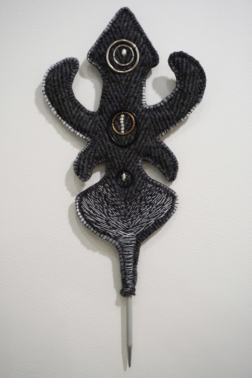 35. Katrina Virgona,  Margherita,  Knitting needle, blanket, found objects, glass beads and pearls $275