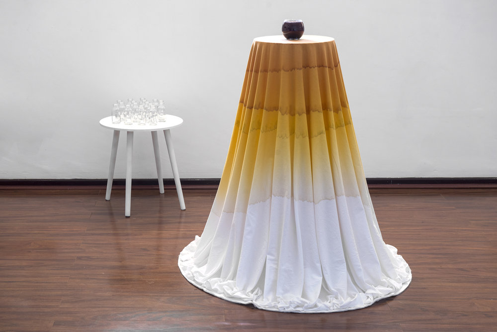20. Louise Monte,  Tides of Tea , 2018, fabric, water, glass vessels, found objects, table, plants, hibiscus roselle flowers, Gardenia jasmonides seeds and pu-erh leaves, 180 x 120 cm x 50 cm, $500. Photograph by Eva Fernandez