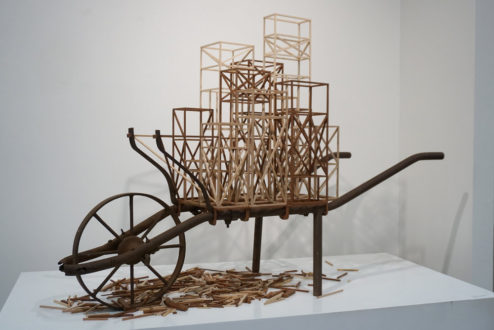 Angela McHarrie,  Out of the shadows , 2018, vintage wheelbarrow frame and various timbers, 111 x 62 x 167 cm, $2,700