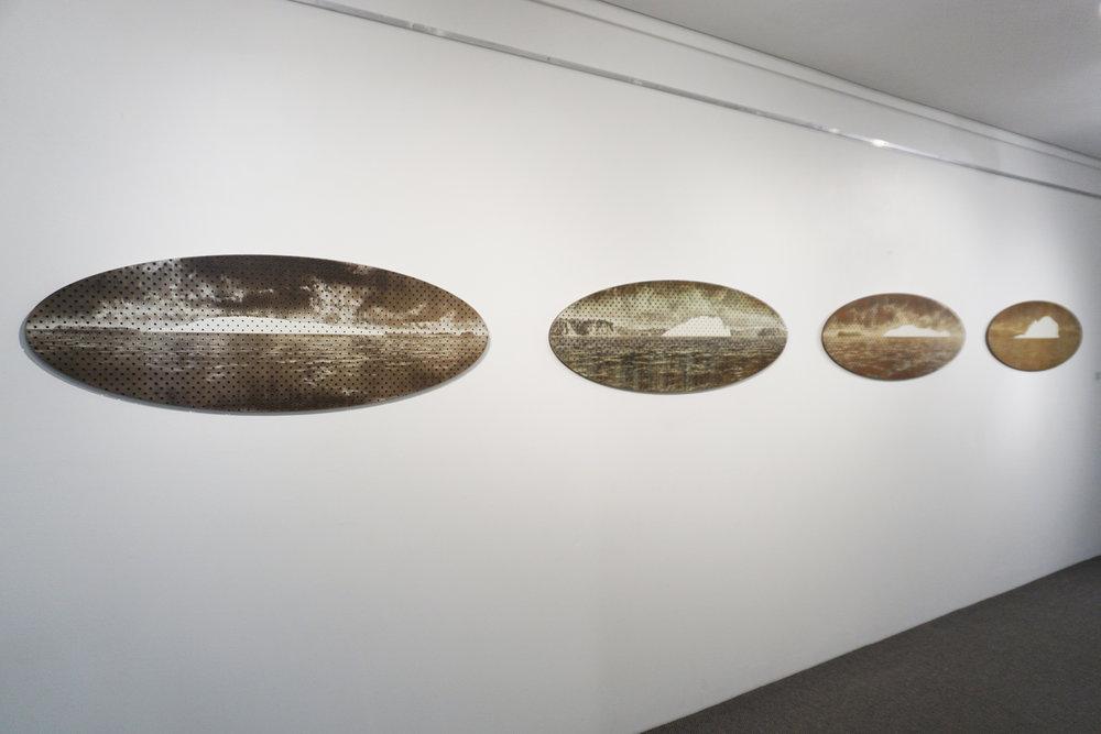 Tony Windberg,  Terra Nullius 1, 2, 3, 4 , 2018, pegboard, sanded rust effect paint and sealnat on MDF, 43.5 x 127 x 1.5 cm. $12,000 set