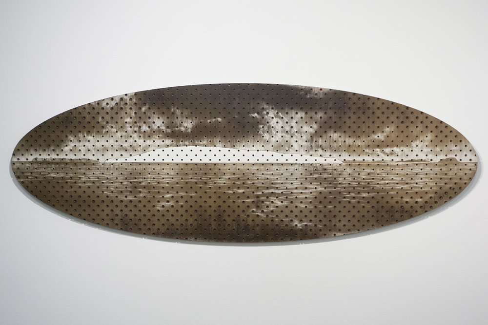 Tony Windberg,  Terra Nullius 4, Seal Island,  2018, pegboard, sanded rust effect paint and sealnat on MDF, 43.5 x 127 x 1.5 cm. $3,400