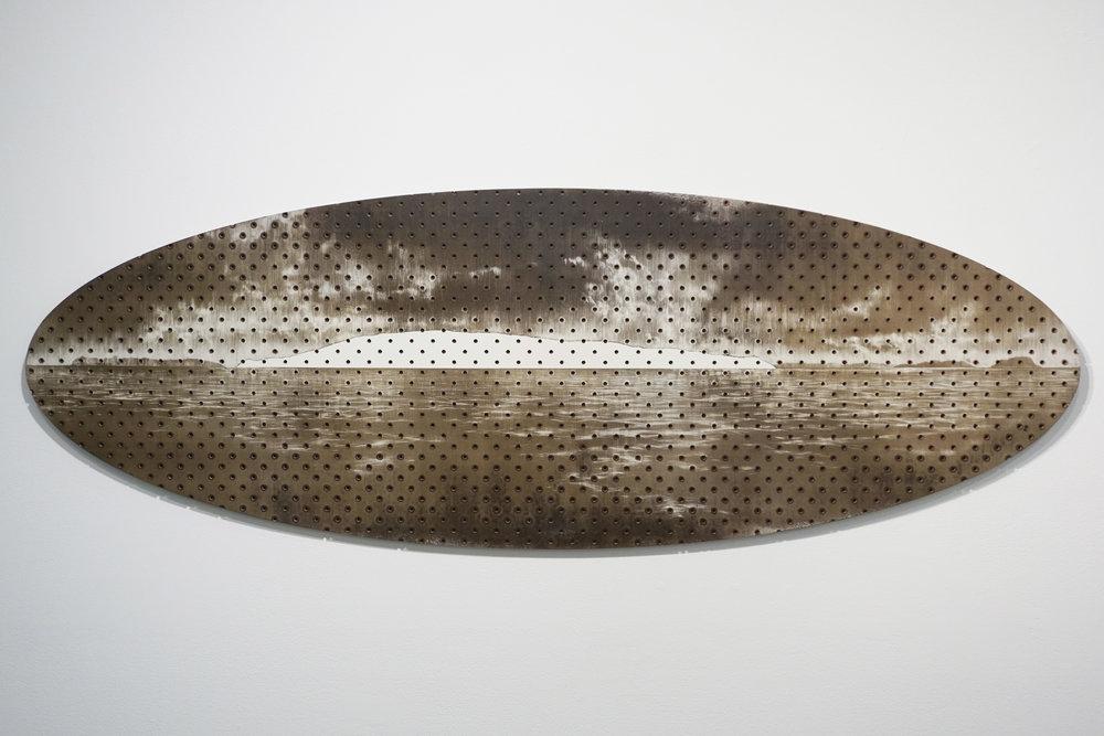 Tony Windberg,  Terra Nullius 4, Seal Island,  2018, pegboard, sanded rust effect paint and sealnat on MDF, 43.5 x 127 x 1.5 cm. $3,400