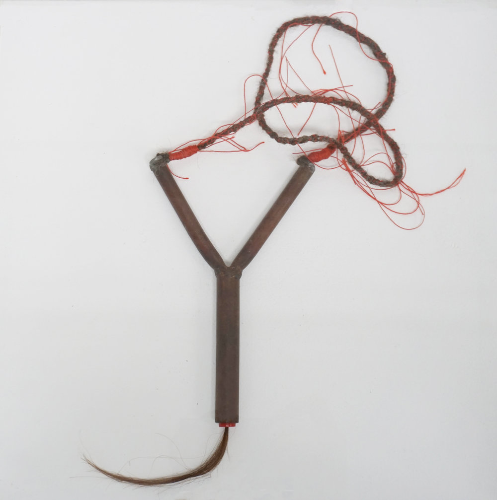 Olga Cironis,  Roses are red, violets are blue, I truly dearly love you II,  2018, farmed steel sling shot, human hair and thread, dimensions variable. $750