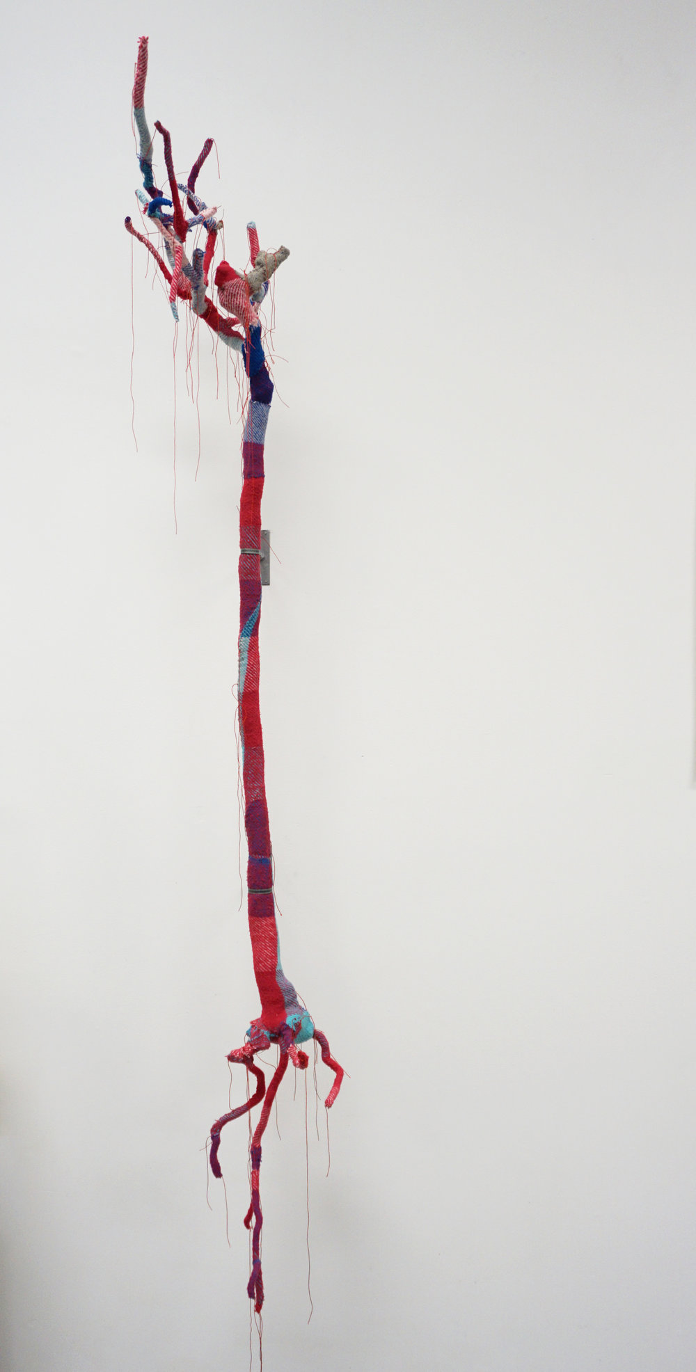 Olga Cironis,  Roses are red, violets are blue, I truly dearly love you I , 2018, rose bush, woollen blanket and thread, 170 x 50 x 50 xm POA