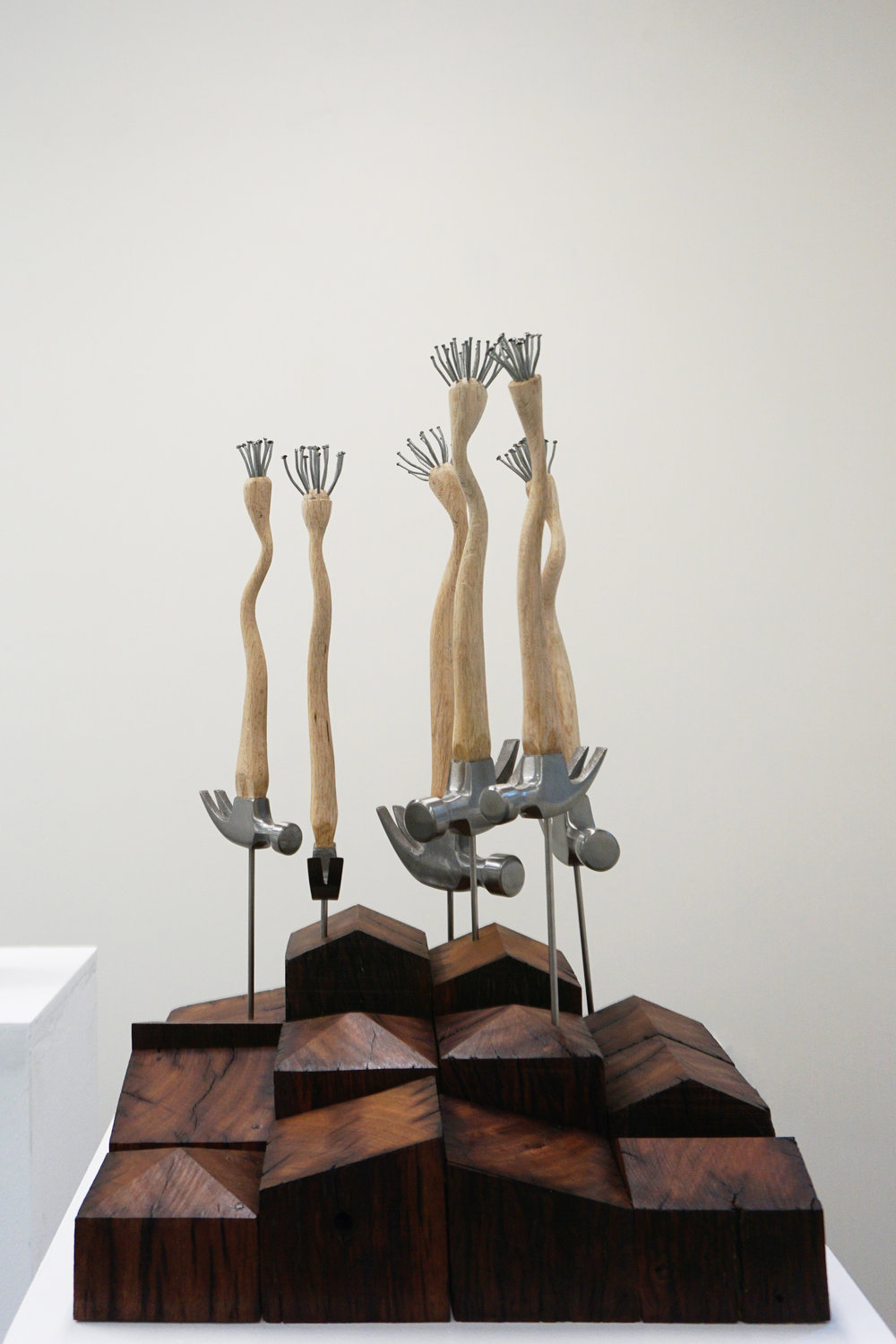 Peter Hill,  Beautiful Work , hammer, galvanised nails, wooden blocks, 60 x 40 x 40 cm $3,500