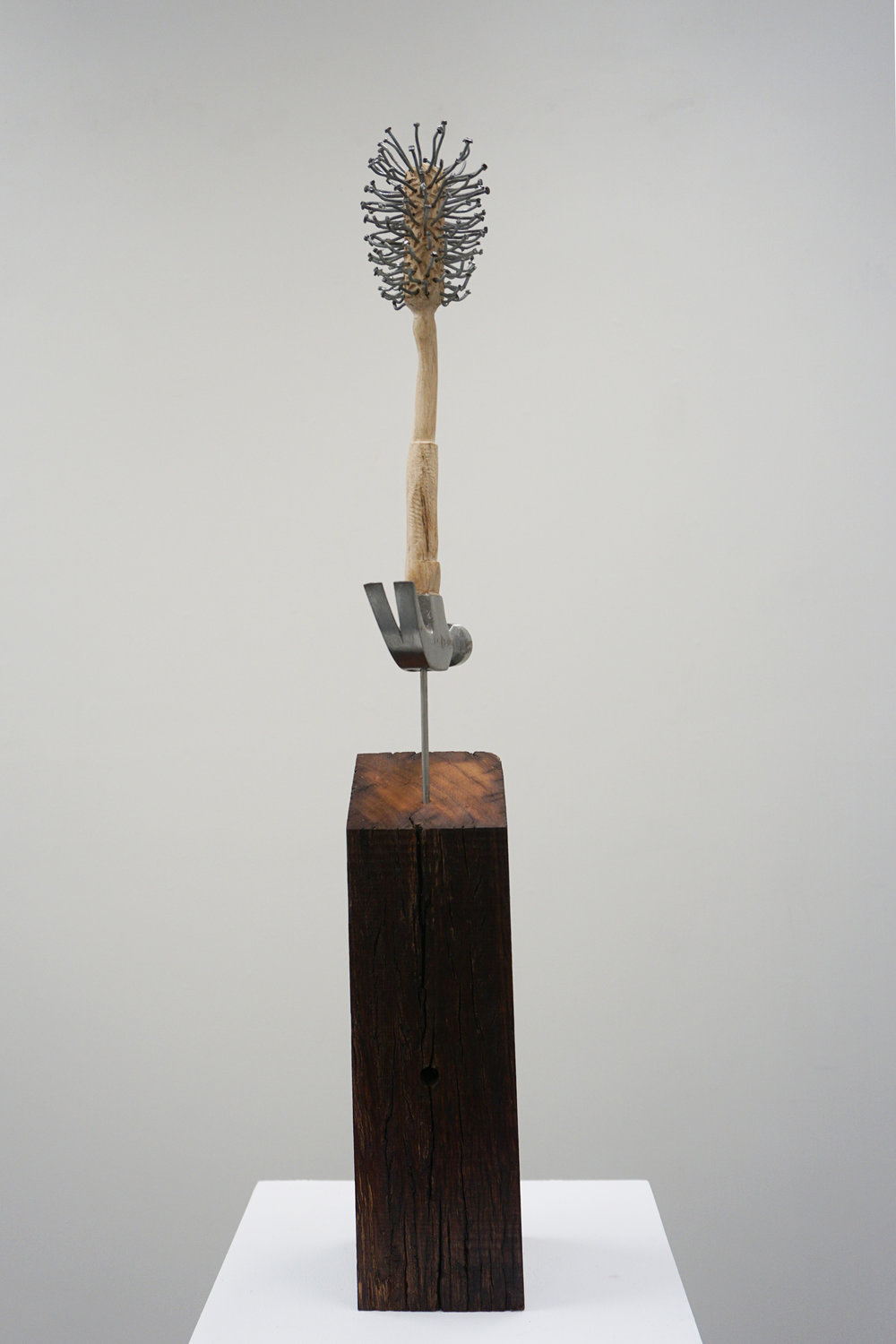 19. Peter Hill, Nice Work, Wandoo, hammer, galvanised nails, stainless steel rod, 75 x 10 x 10 cm $1,600