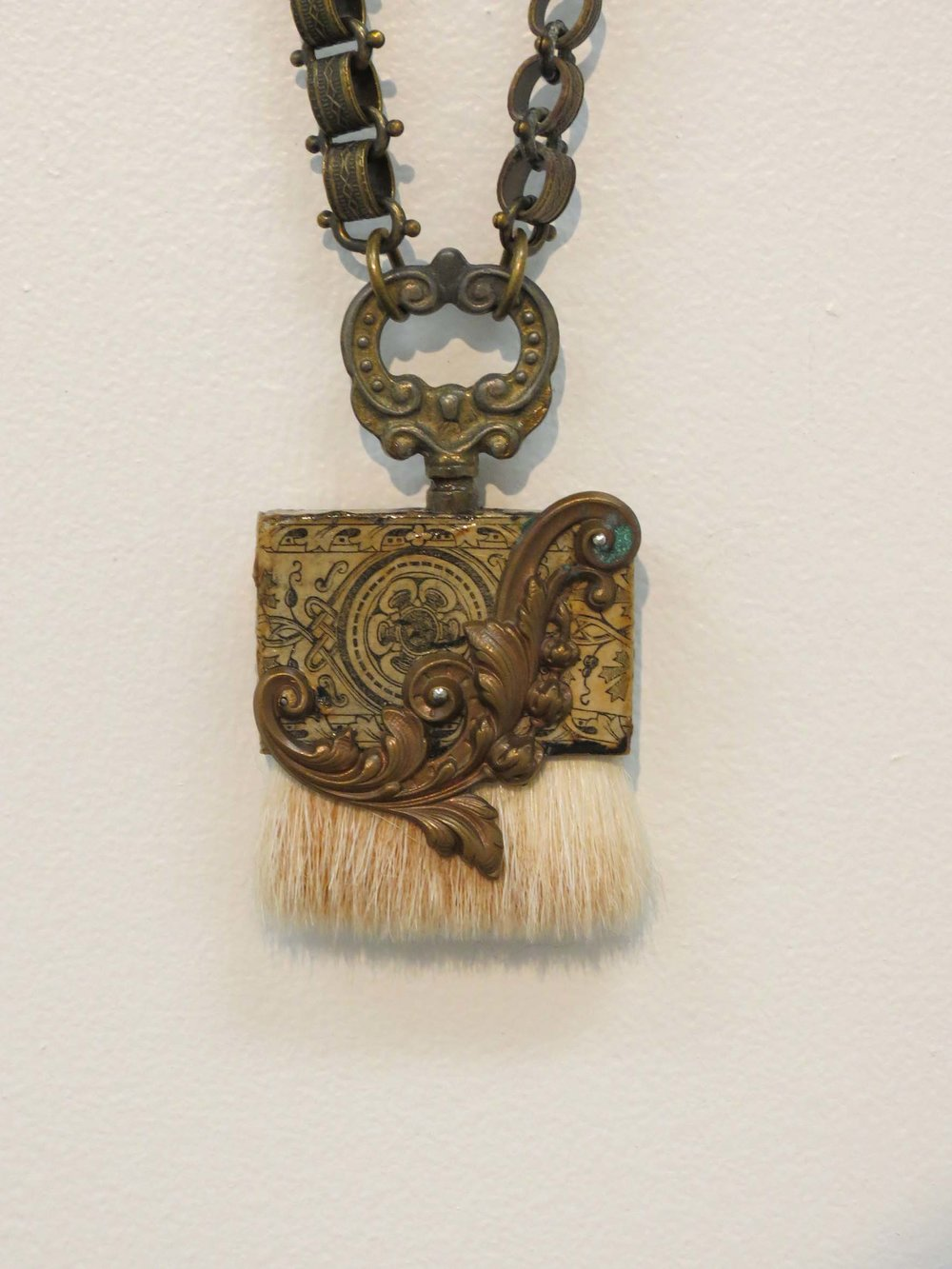 11. Kathy Aspinall, 'Brush II', 2018, wooden brush, clock key, brass, antique paper, book chain, necklace, $295