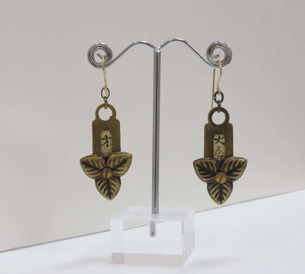 18. Kathy Aspinall, 'Brass', 2017, brass, Japanese paper, resin, earrings, $175