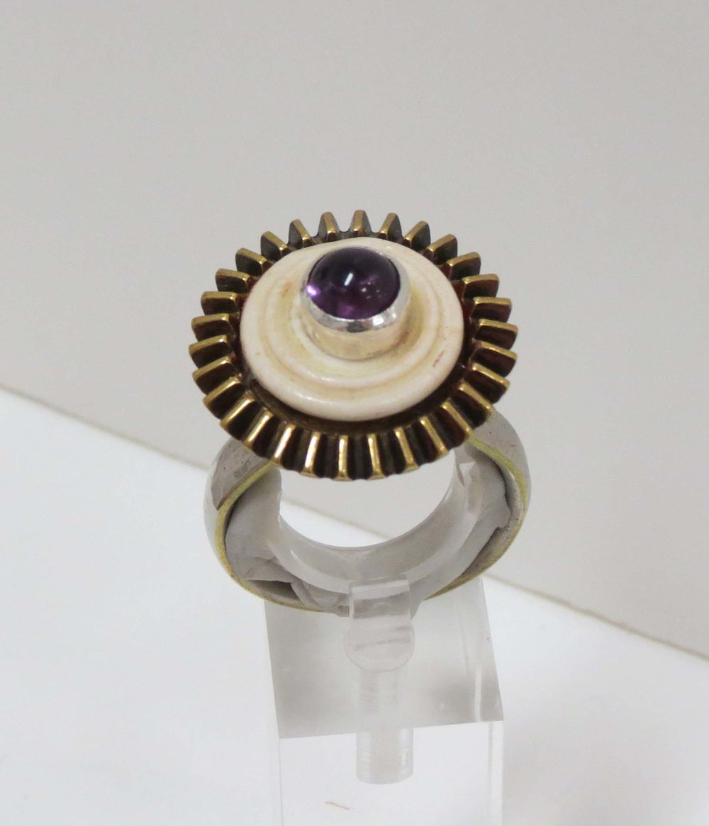 25. Kathy Aspinall, 'Royal Cog', 2018, steel, brass, bone, silver, amethyst, Man's ring (size Z), $300