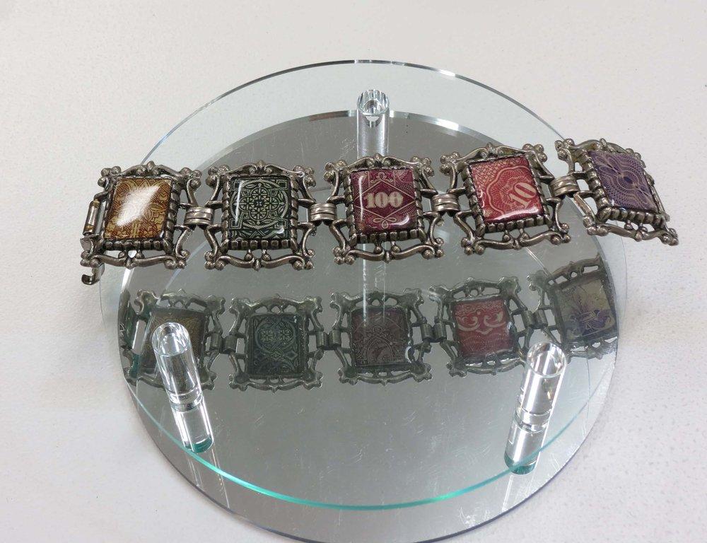 27. Kathy Aspinall, 'Bond', 2018, 1930's bracelet, Japanese bonds, resin, bracelet, $320