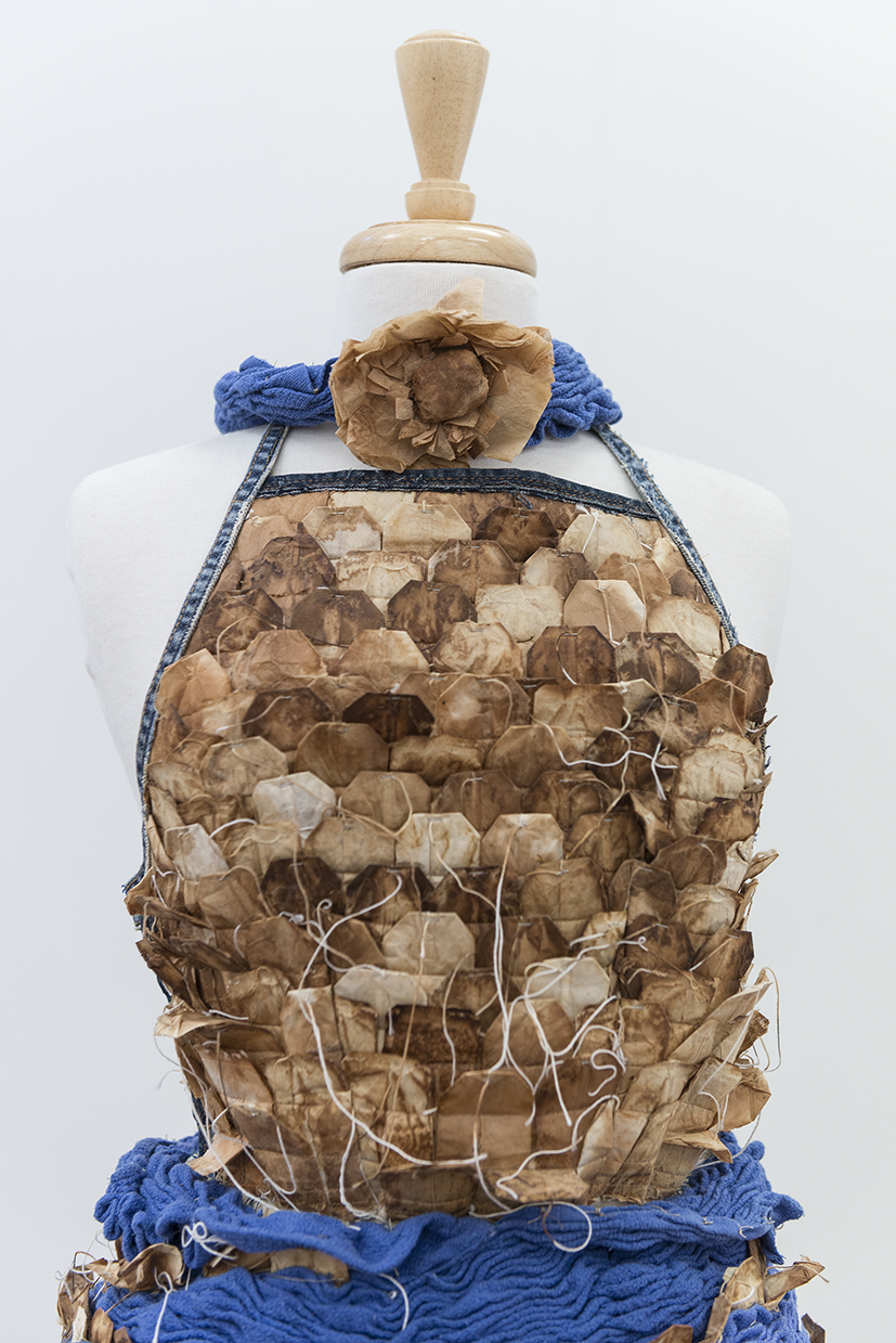 28. Louise Wells,  Once , 2014, used teabags, blue fabric from surgical instrument trays, old jeans, petticoats, sheets, plastic drain-cleaning pipe, teabag string, cotton. $500.