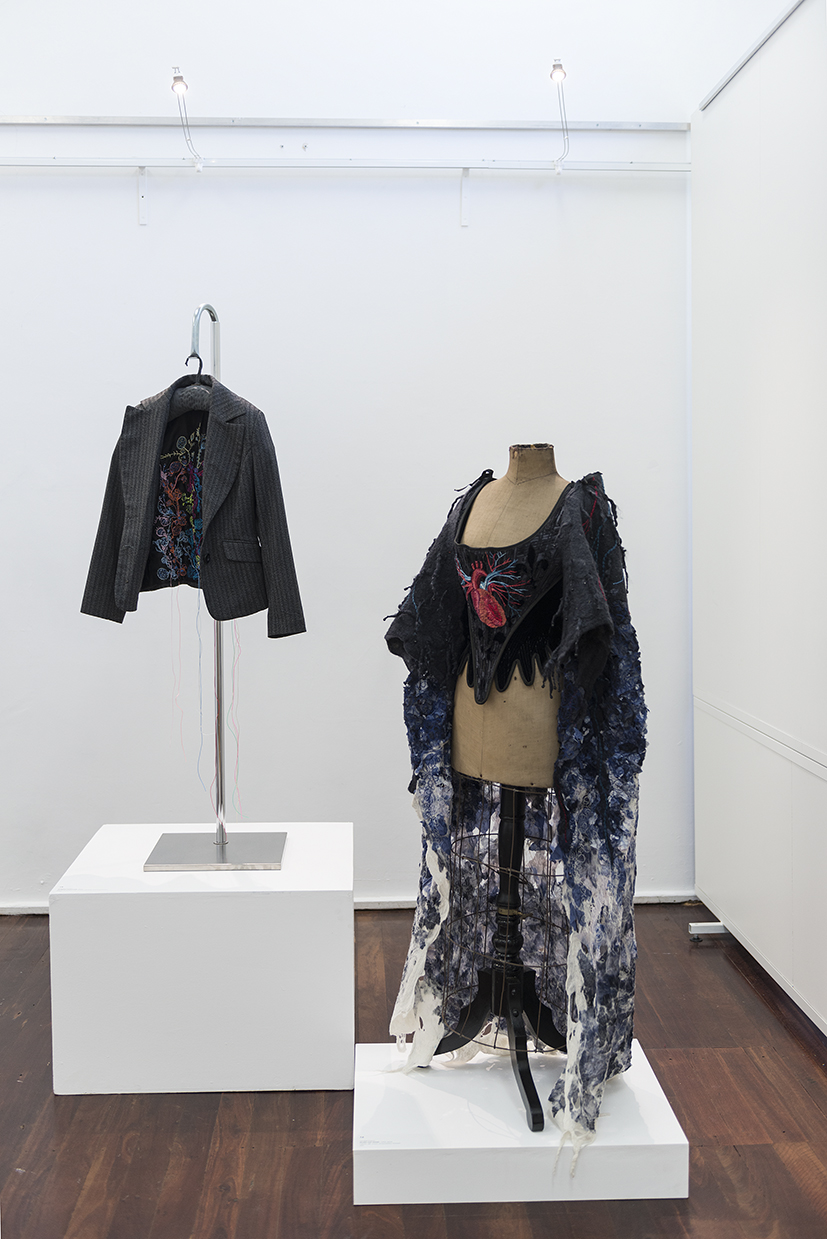 15. Angela Ferolla,  Internal Dialogue , 2018, Op shop jacket with screen printing, embroidery thread. $550.   16. Lyndell Darch,  Worn Out Heart,  1994/reworked in 2018 velvet, silk, wool, embroidery thread. NFS.