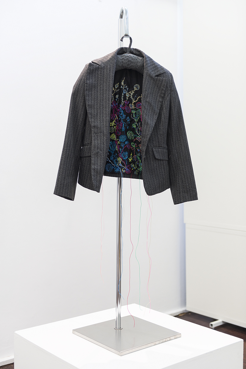 15. Angela Ferolla,  Internal Dialogue , 2018, Op shop jacket with screen printing, embroidery thread. $550.