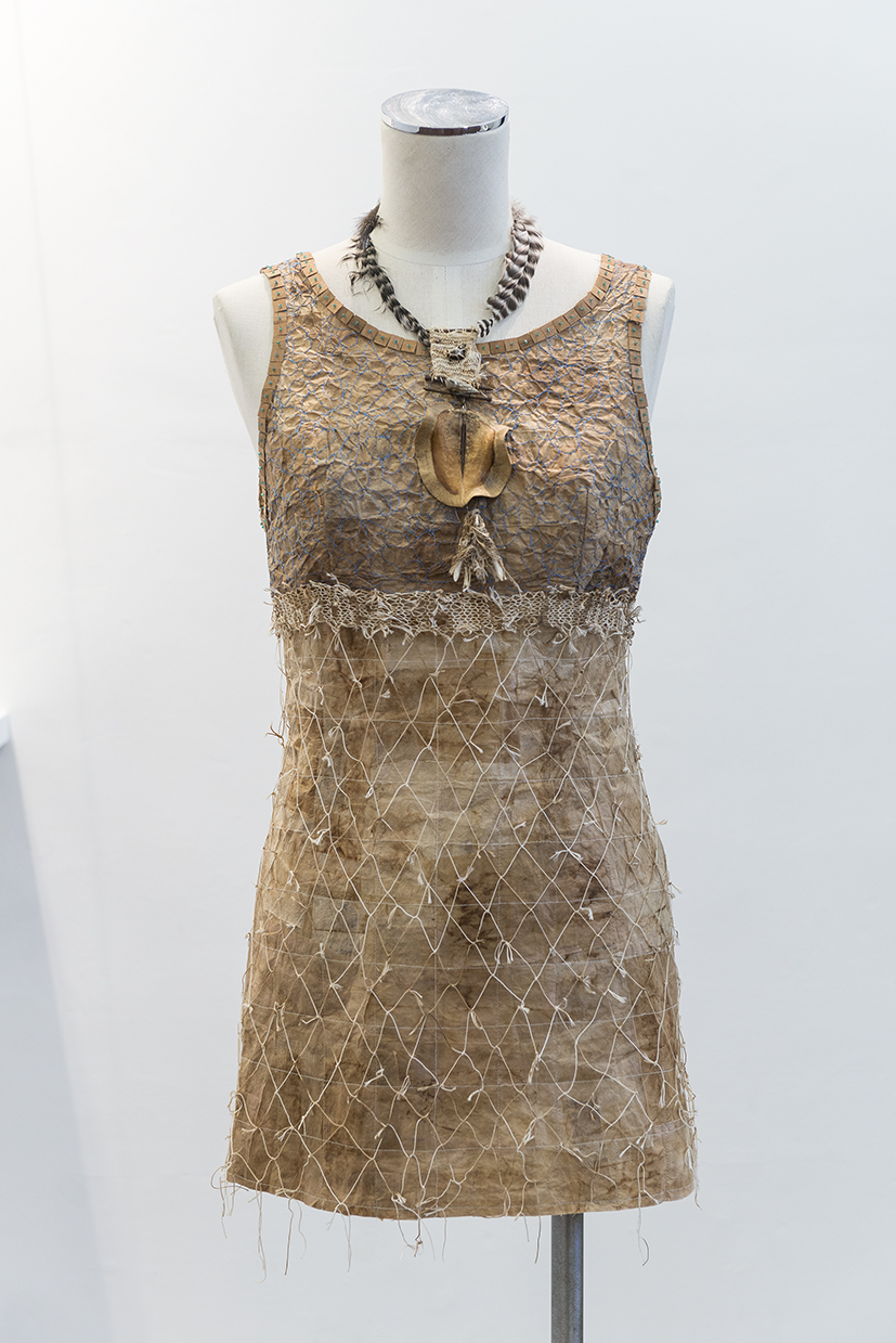 12. Andrea Day,  Teaser , 2018, used teabags, teabag string, cotton, wood veneer, sea beads, dress closures. $700.