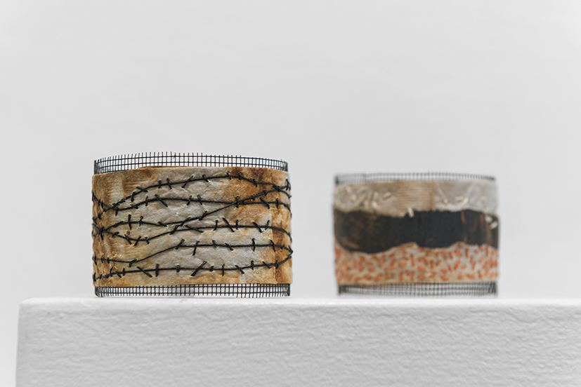 11. Andrea Day,  Bangles 3-4  2018, sandpaper, fly screen, wood veneer, beads, waxed linen, cotton, thread, used teabags. $30 each.