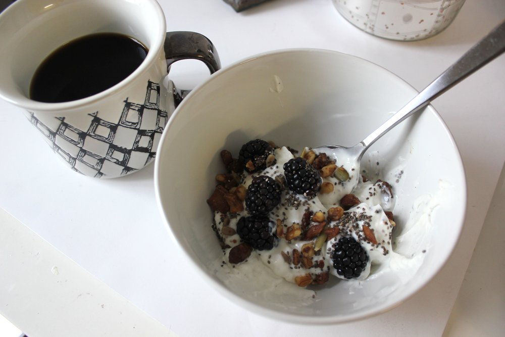 two | a good morning - greek plain yogurt, grainless granola (from trader joes), chia seeds, black berries, and café bustelo.