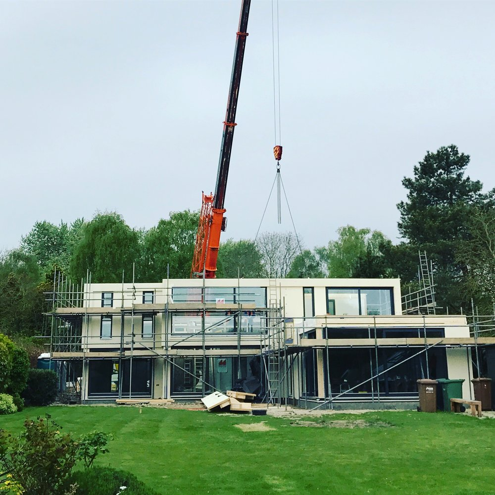 Pre-fabricated panels craned into place