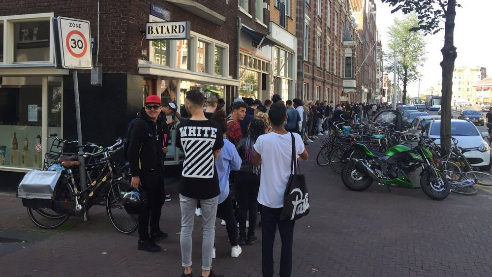 Shoppers wait in long lines at the launch of Kanye West's pop up store on Amsterdam's Rozengracht. Image credit:  AT5
