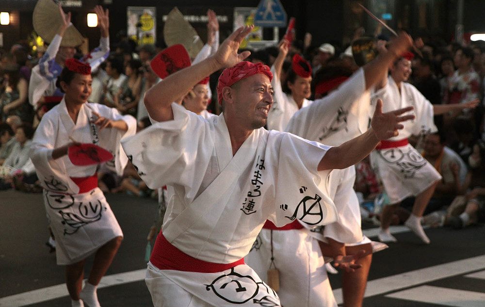 Dancers and musicians perform at the Awa Odori festival in Koenji in Tokyo. The dance festival is part of the summer Obon celebrations in Japan in which Japanese honor the spirits of their ancestors.