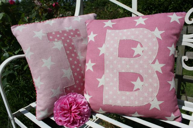 star initial cushion in pinks