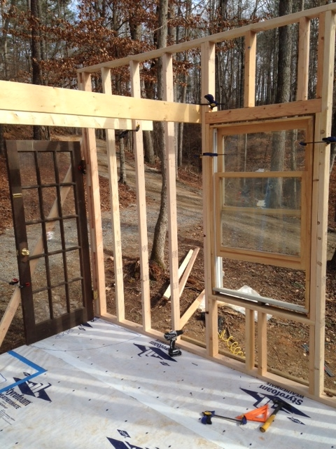 A view from inside. The boards clamped between the door and the window (above) represent where the floor joists for the sleeping loft will be.