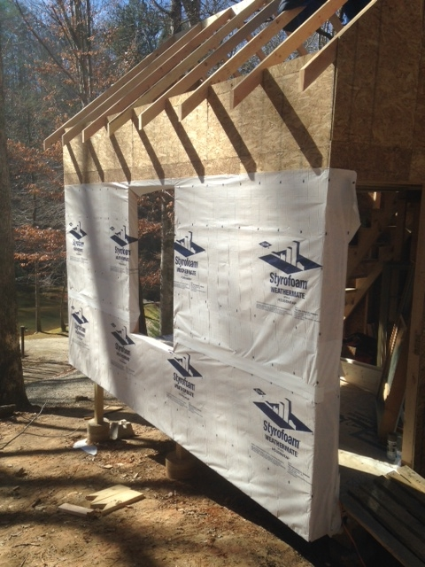 Starting to install the house wrap. Hope to finish it before the weekend, when it's supposed to rain.