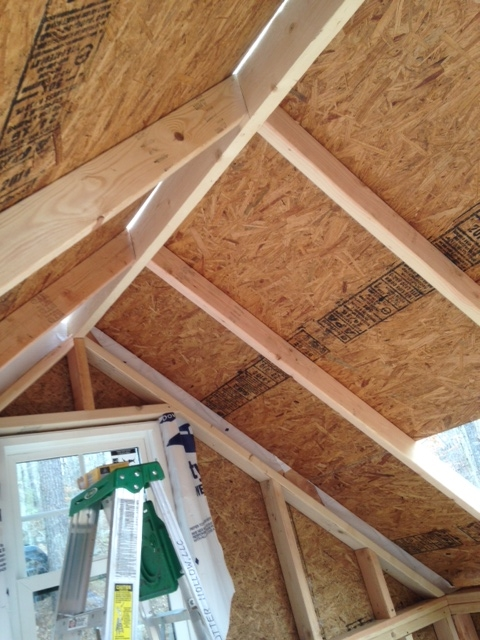 An inside view of the roof sheathing being installed.