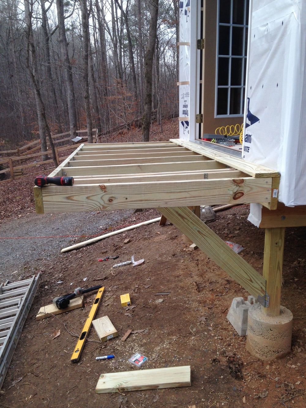 Framing the deck. It's small, but perfect for a pair of Adirondack chairs, a side table, and a couple of cocktails. Two drink maximum right now, until I get the railing installed!