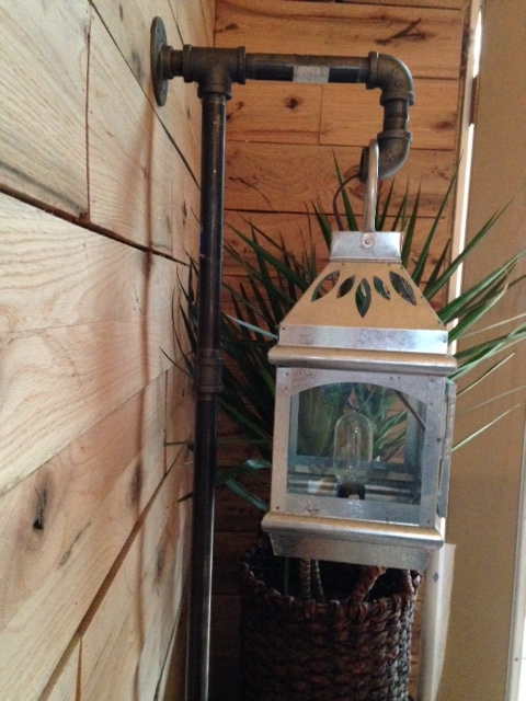I ran the wiring through the wall and the pipe. I installed a simple bulb holder with a twist switch protruding out the bottom. It was originally intended to hold a candle.