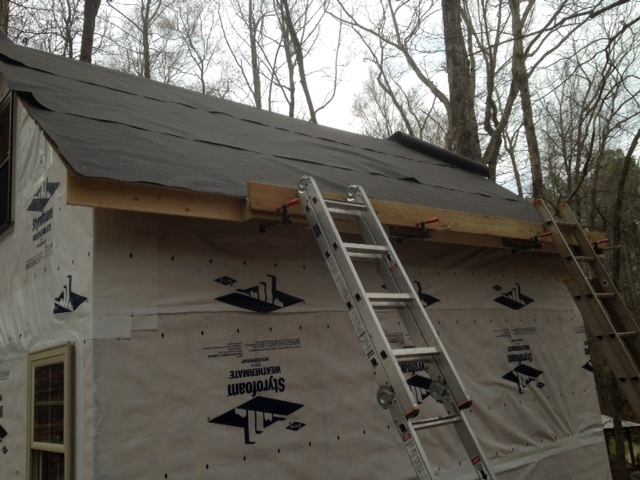 We got the roofing felt up, then had to figure out how we were going to install the metal...