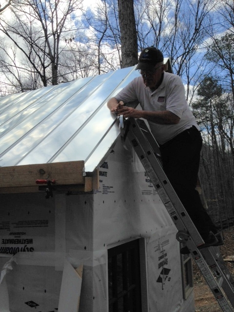 My dad doing a little work on the drip edge. Couldn't have put this roof on without his help.