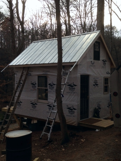 The roof, almost finished. We have to trim the gable drip edges and install the eave drip edges, then we'll be good up top. Some siding, and a bunch of little work, and it should be inhabitable.